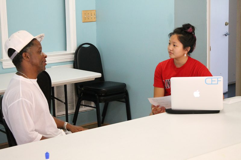 Anne Yeung conducts a mock interview during a CEF interview skills class planned and facilitated by Gary Bradley, a graduate of both CEF and Housing for New Hope. Bradley is also pictured.