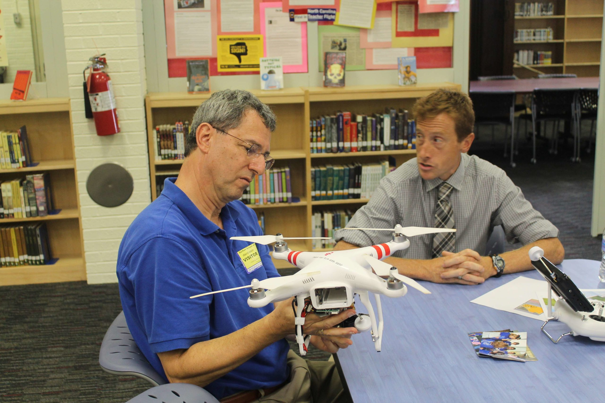 David Stein demonstrates how to utilize a camera in conjunction with a quadcopter. Chris Huggins, a 7th grade science teacher at Durham School of the Arts, met with David to learn about the quadcopter and determine whether or not the purchase of one would benefit his students.