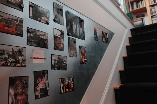 """Along the stairwell of Amanda's two-story condo (pictured above) is a wall full of snapshots – President Obama when he visited Durham in 2011, American Dance Festival banquets, international travel. """"You want to have a place to put your pictures up, but you can't frame everything,"""" she says of the photos. Her solution was to get the staircase wall covered with a magnetic steel plate. It's now one of her favorite parts of the condo."""