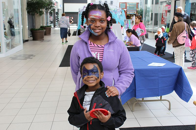 Brandon Hawkins, 4, and Sydney Hawkins, 6,  showing off their fun facial art.