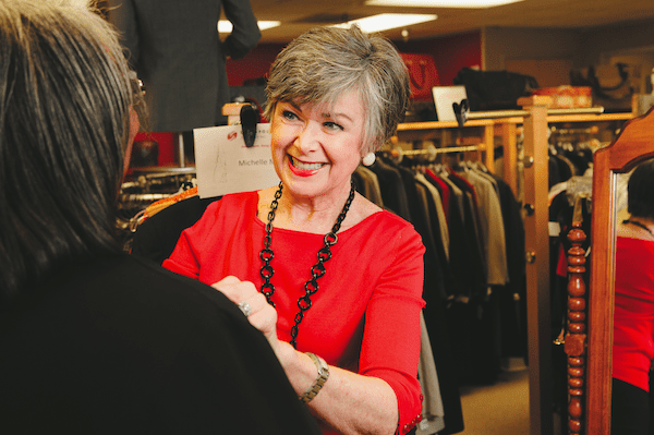 Pat helps Michelle Miller pick out a new outfit in the Dress for Success store at Northgate.