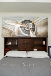 A metallic theme runs through the decor in the Ellis' apartment, like this piece above Nik's bed.