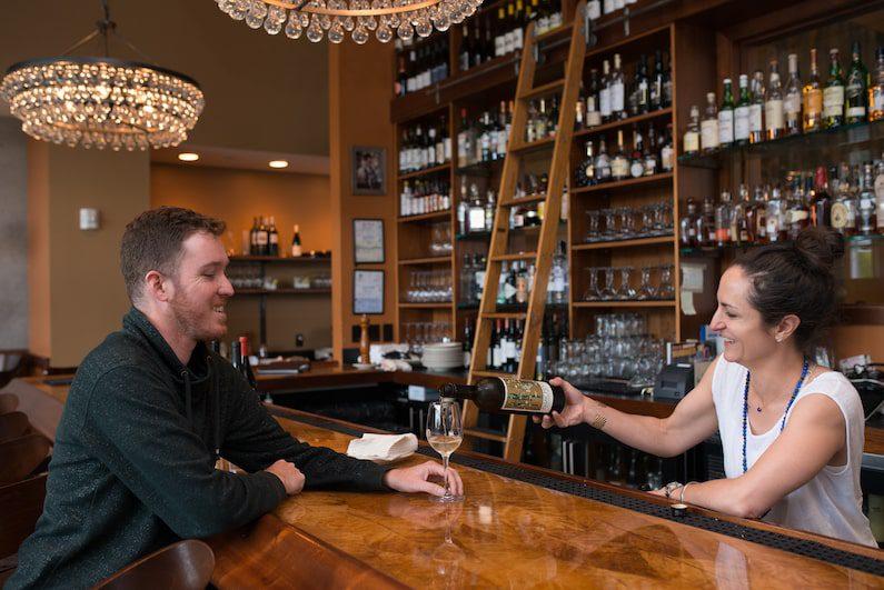 Matt Lardie drinks wine at NanaSteak