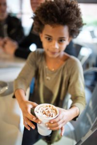 During a family outing at Joe Van Gogh's Woodcroft location, Vendela Julin, 7, orders a hot chocolate.