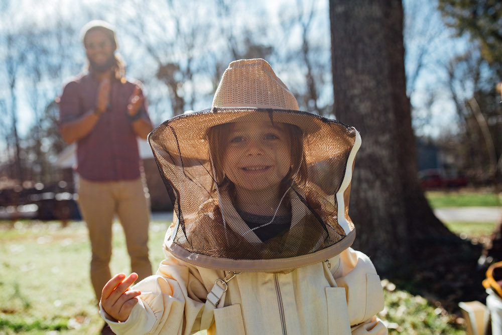 beekeeper and bees