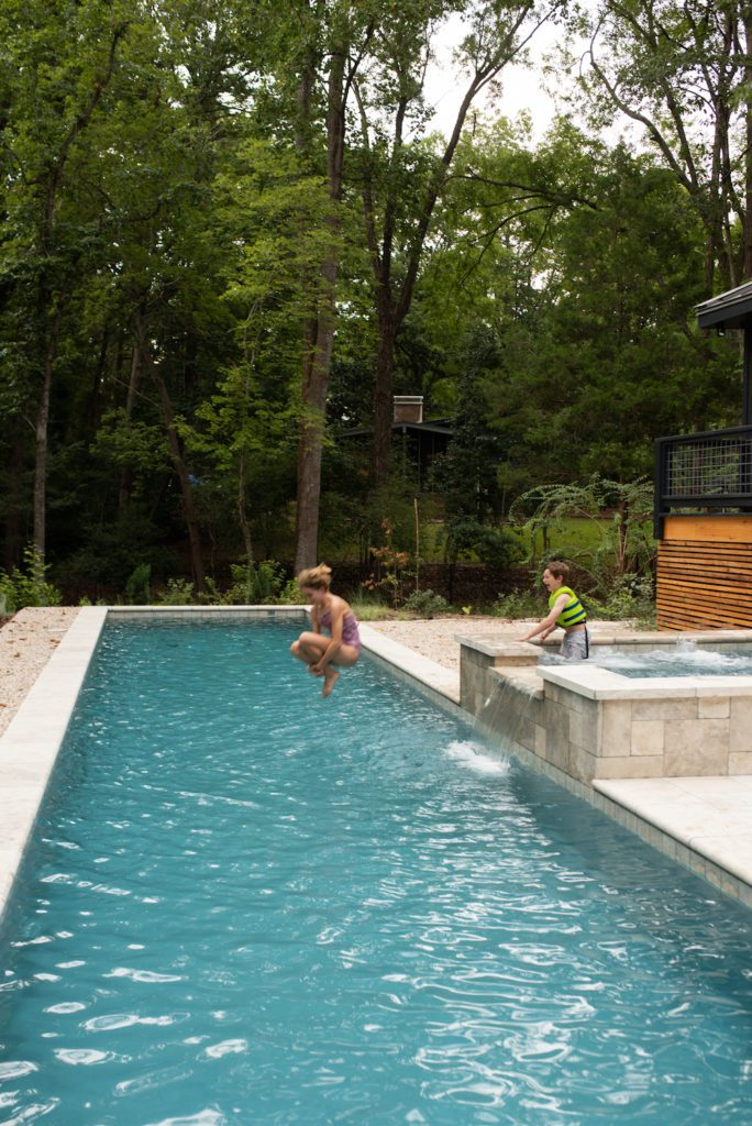 Families spend time in the pool