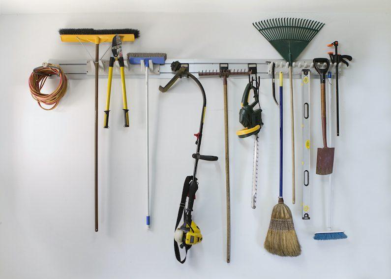 Neat garage tools hanging on a storage rack