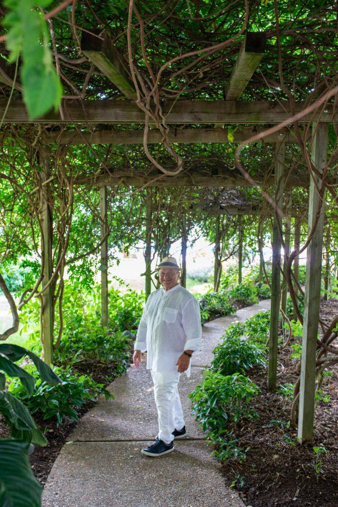 Giorgios under a vine-covered arbor