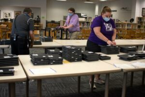 Organizing laptops at the start of the school year to be distributed to students at Riverside High School
