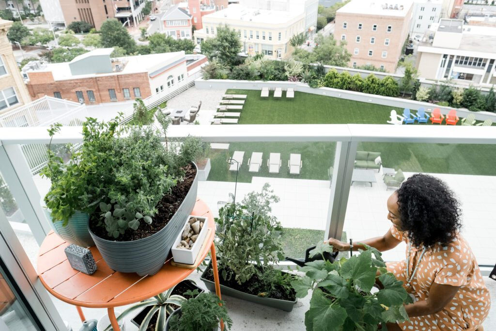 Nicole Oxendine has a garden on her balcony in downtown