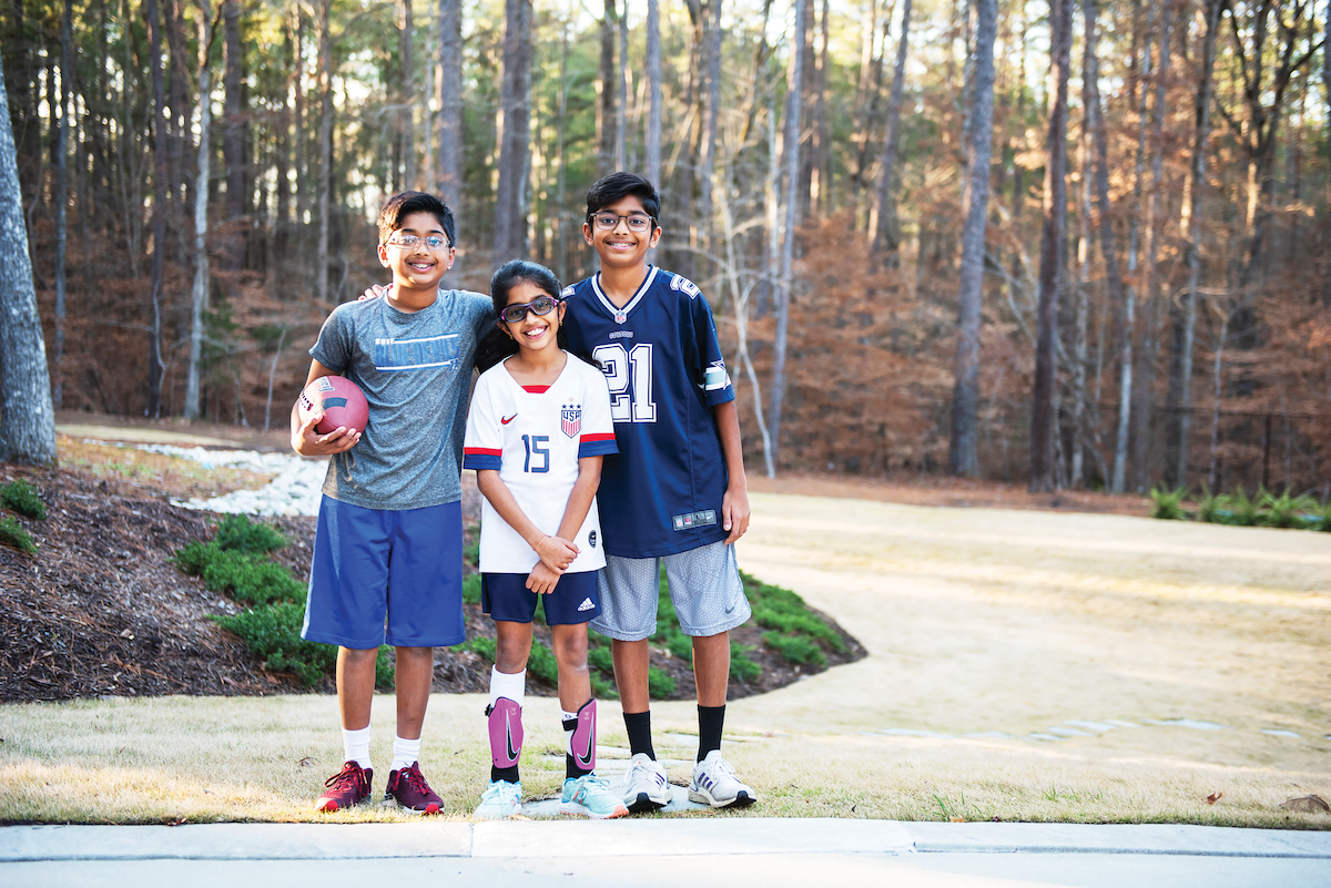 all three Parekh kids in their yard