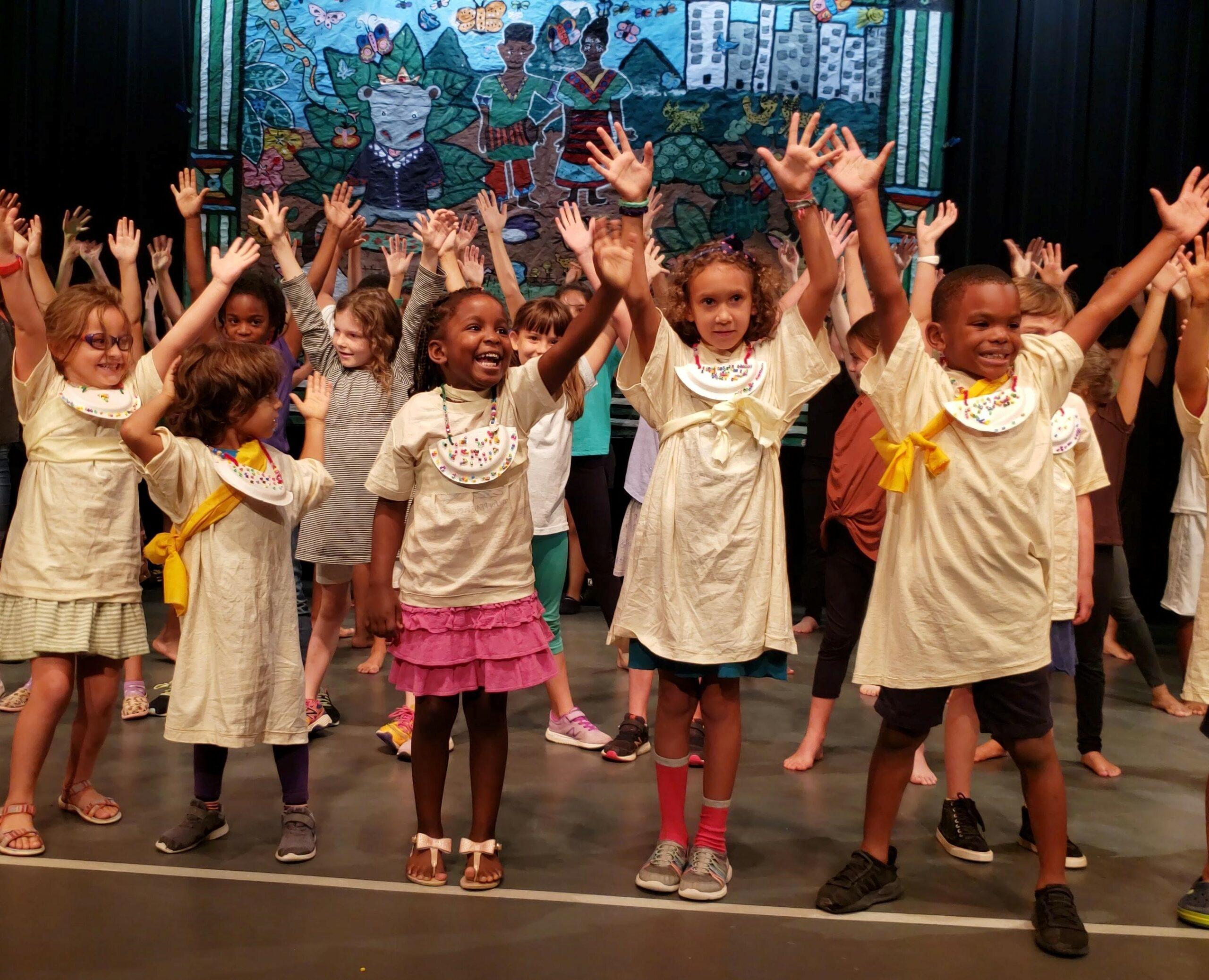 Children waving at DAC camp