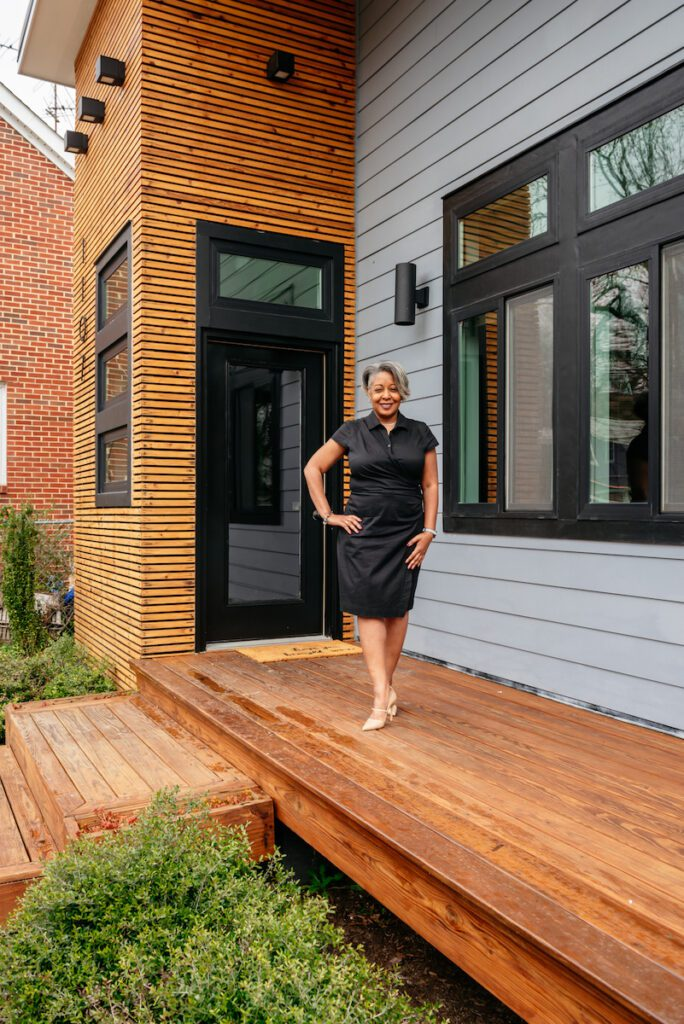 Nicole McCoy in front of her modern home