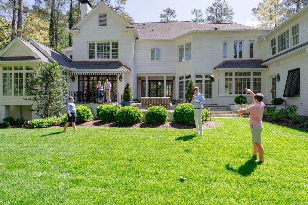 The Hogan boys toss a football around in the backyard.