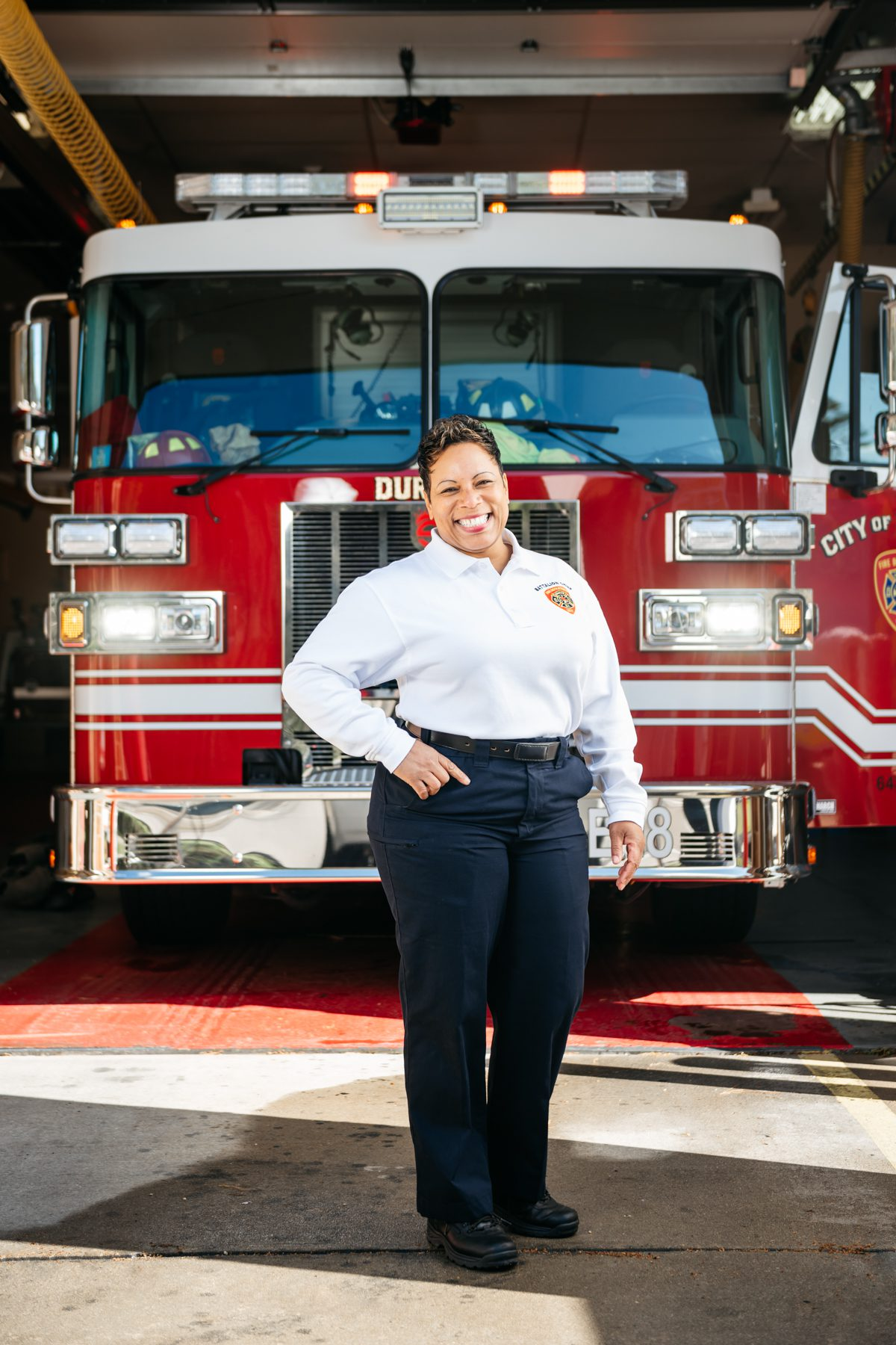 Angelica Stroud Greene standing in front of a fire truck