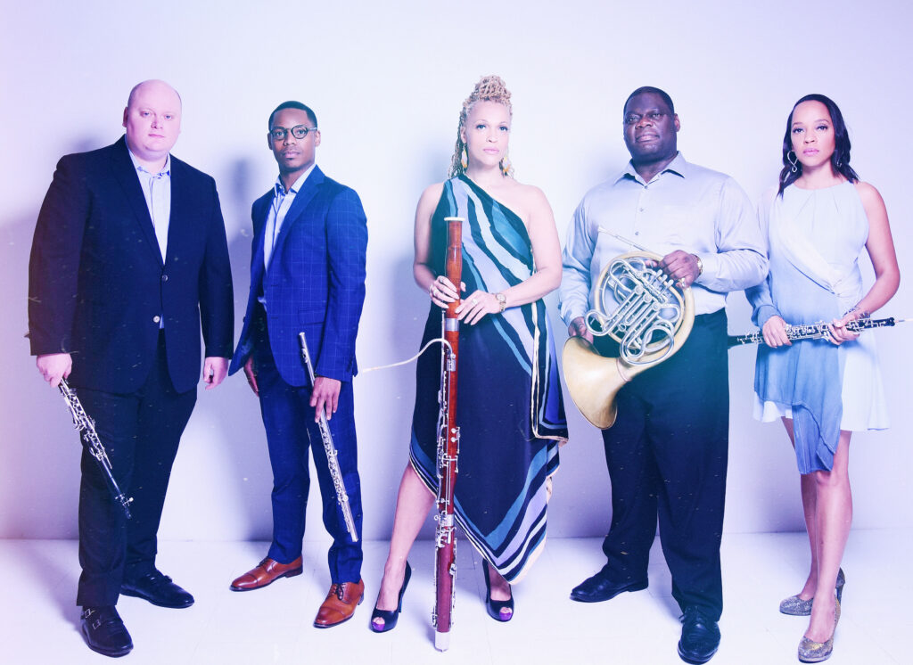 Events in Durham – Grammy-nominated quintet Imani Winds stand side by side with their instruments.